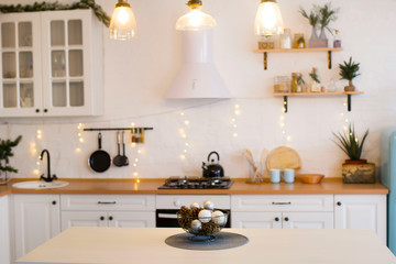 Picture of kitchen in Christmas decorations. New Year and Christmas 2019.