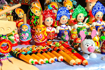 """Traditional handicraft wooden souvenirs at street gift store near complex """"City of Craftsmen"""" on the banks of the Volga River, Gorodets, Russia."""