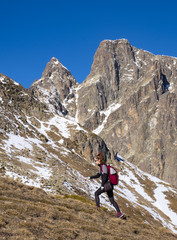 Girl walking in the Midi d'Ossau in the French Pyrenees.