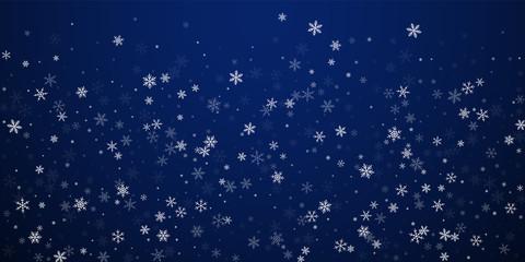 Sparse snowfall Christmas background. Subtle flyin