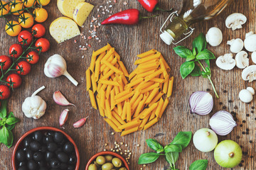Stylish composition of italian ingredients and food on the vintage wooden table. Culinary backgrounds. Top view. Heart shape.
