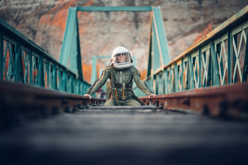 Female astronaut on train tracks