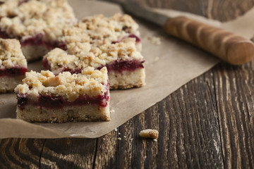 Raspberry bars on rustic wooden table