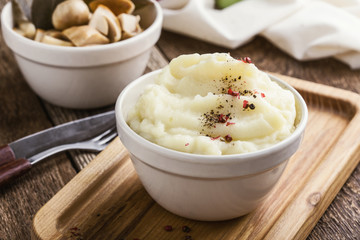 Mashed potatoes on wooden table, vegetarian meal