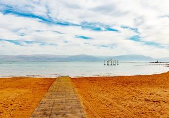Pier on the beach over Dead Sea.