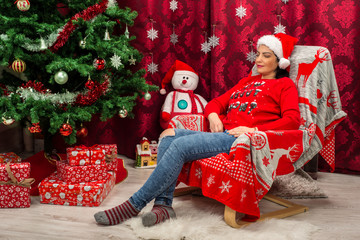 Dreaming Christmas woman in chair