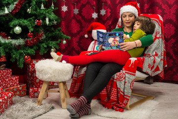 Mother and son reading Christmas book together