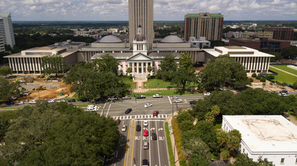 Flags Blow Atop Traffic Below The Capital Dome in Tallahassee Florida