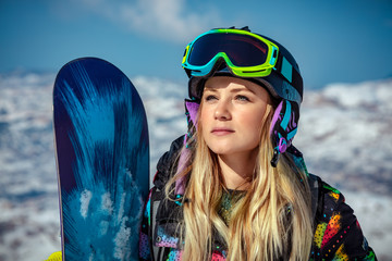 Beautiful woman with snowboard