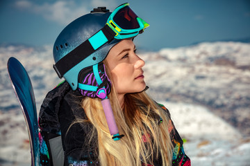 Sportswoman with snowboard