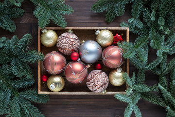 Christmas tree decorations in a wooden box