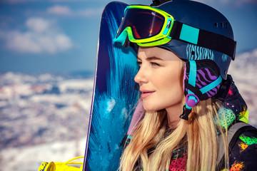 Sportswoman with snowboard
