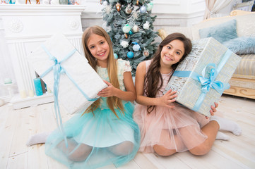 delivery christmas gifts. Family holiday. happy new year. happy little girls sisters celebrate winter holiday. christmas time. little children girl with xmas present. Decorating tree for Christmas