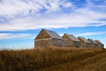 old abandoned grain huts on farm
