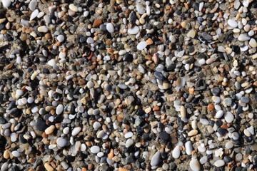 Sea little pebble texture. Beach stones surface. Marine mineral beauty harmony.