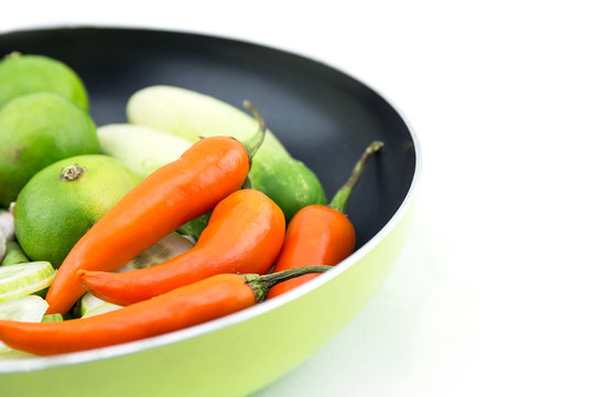 orange, mini sweet peppers in pan