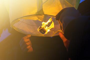 Launching a green lantern into the night sky