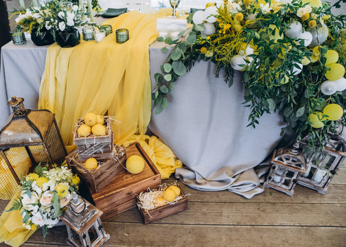 Wedding decorations. Festive banquet. Beautiful wedding decor with many flowers, lemons, balloons and candles. Celebration, top view