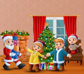 Happy santa claus holding a gifts for children