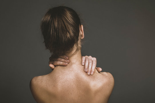 Woman suffering for chronic neck pain.