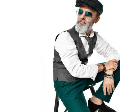 Old brutal senior millionaire man in white shirt and aviator green sunglasses stylish fashionable men