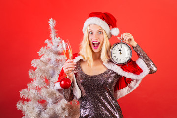 Cute young woman with santa hat. Funny girl in santa clause costume. Portrait of a young smiling woman. Funny Laughing Surprised Woman Portrait. Event.