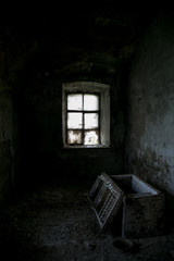 Dark room of abandoned mansion. Opened old chest