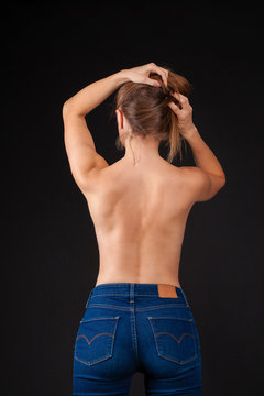 Back view, sexy young woman in denim jeans