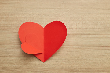 Valentine's day red paper heart on wooden