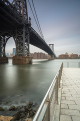 View on Williamsburg bridge from the pier at sunrise with long exposure