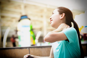 Beautiful girl has accident while exercise and running in the morning. Injury to the neck muscles. When she was jogging down at the stairs and had severe pain. Soft focus and blur.