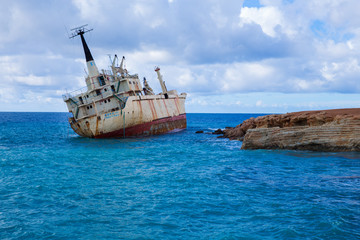 Garden Poster Shipwreck Old ship wreck and blue water beach. Travel photo 2018, december. Landscape and nature.