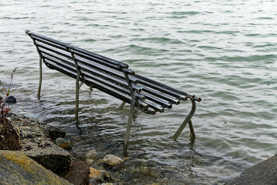 Park bench swamped by a rising sea level