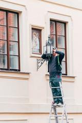 electrician repairing a streetlamp