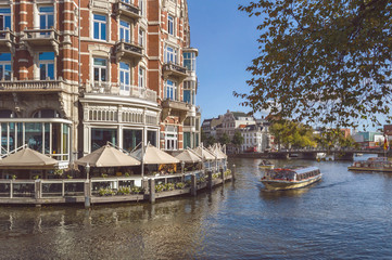 terrace of rastaurant with canal view in Amsterdam