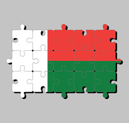 Jigsaw puzzle of Madagascar flag in two horizontal bands of red and green with a white vertical band on the hoist side. Concept of Fulfillment or perfection.