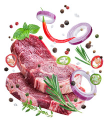 Foto auf AluDibond Fleisch Falling down meat steaks and spices. Flying motion effect of cooking process.