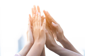 Group of diversity people volunteer success teamwork Gesture high five Together or greeting power of tag team. friends unity togetherness in Volunteer community. Collaboration new generation concept.