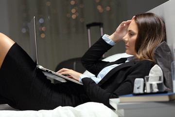 Tired businesswoman working during a business travel