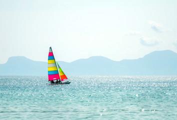 Colorful catamaran sailing in the sea