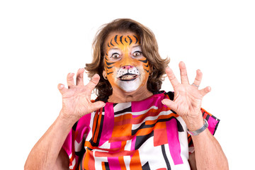 senior woman with tiger face-paint