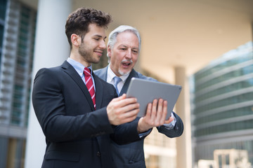 Business people using a tablet together