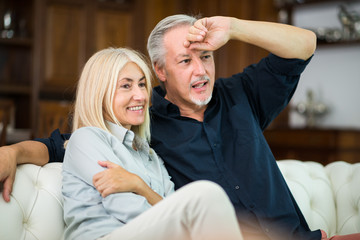 Mature couple watching a tv show together