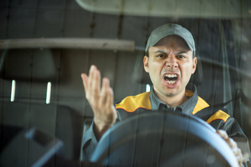 Angry driver shouting in his vehicle