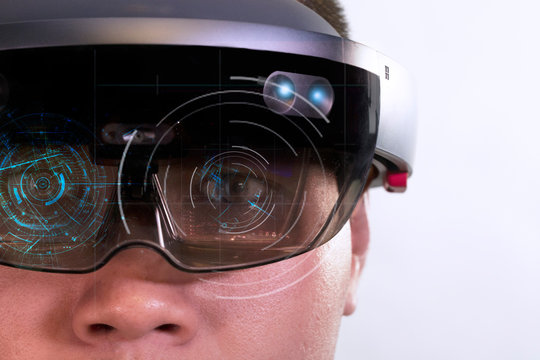 Portrait of young man with 3D virtual reality glasses hololens on white background