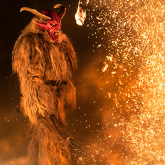 The Krampus masks in an exhibition in the night in Tarvisio, Italy