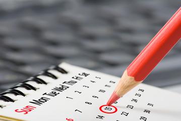 image of calendar and pencil close up