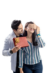 Young asian couple celebrating valentines day with giving a gift