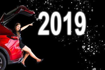 Women with Car tail light red color with 2019 on black background for customers.