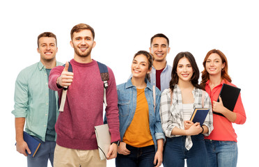 education, high school and people concept - group of smiling students with books showing thumbs up over white background